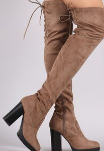 Thigh high boots with lug sole